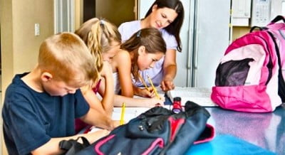 A mother helping kids with homework